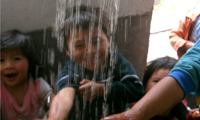 Kids testing hot water